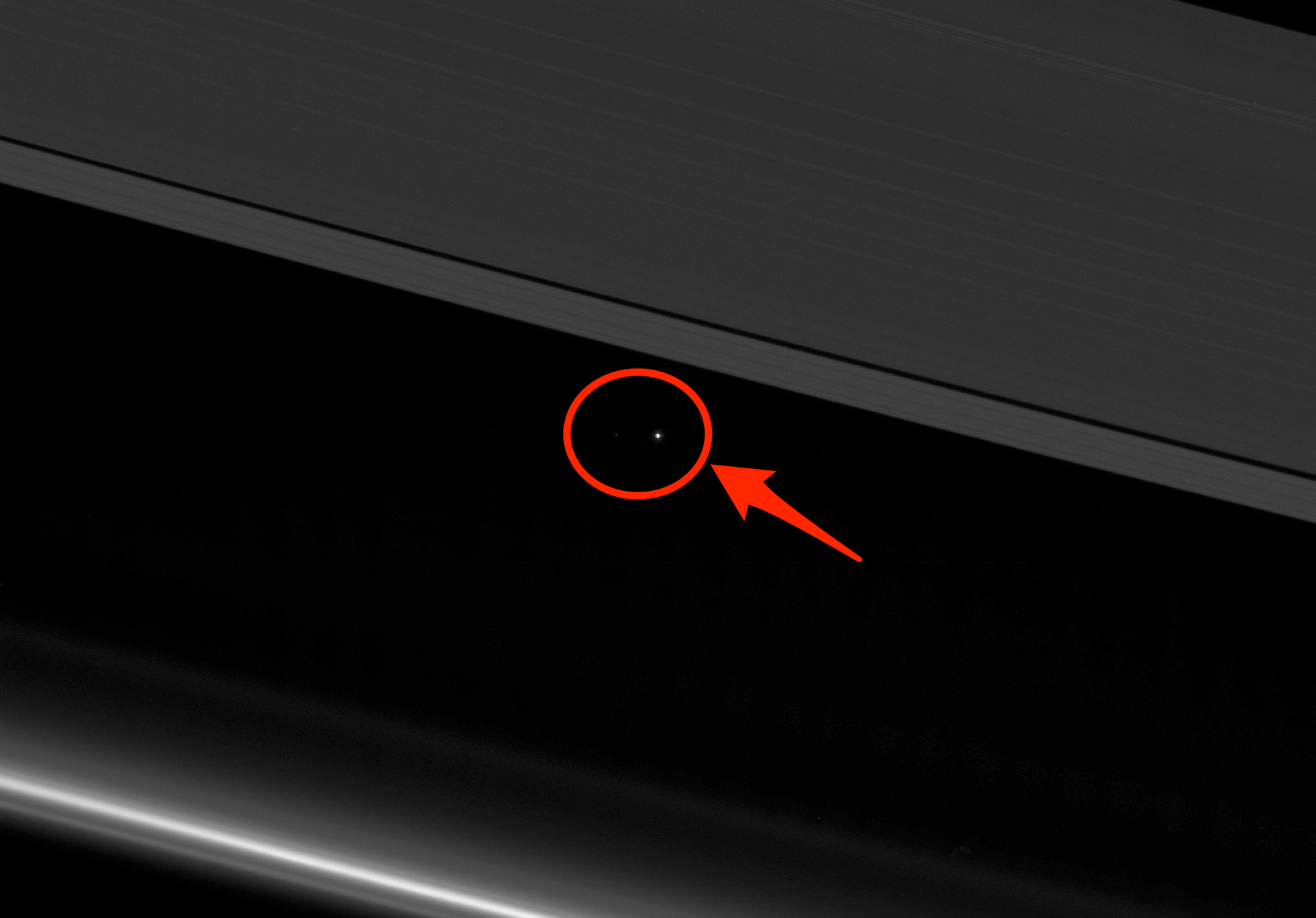 58fa3a3c0ba0b8db158b506c-1920-1339  Earth Seen Between Saturn's Rings.png
